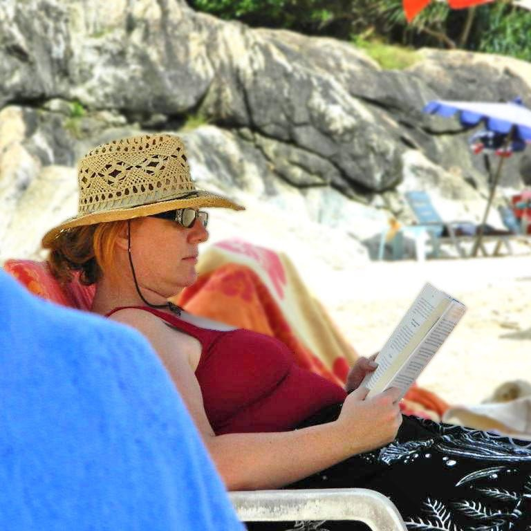 Reading at the beach in Thailand_edited